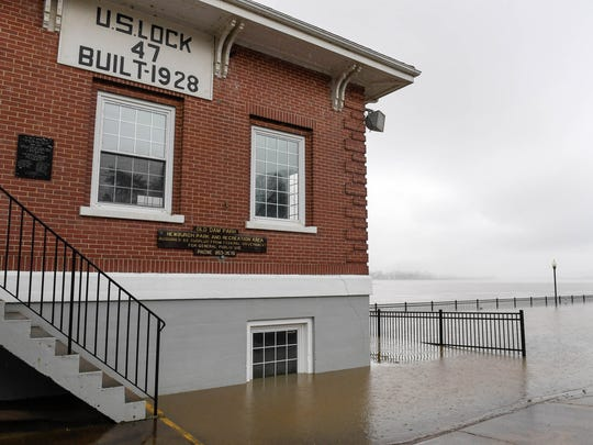 """Ohio River flood waters surround the old U.S. Lock and Dam in Newburgh as river waters continue to rise in the Tri-State area Saturday. Flooding is expected to get worse as afternoon storms are expected to bring wind, some flash flooding and a chance for """"isolated tornadoes,"""" February 24, 2018."""