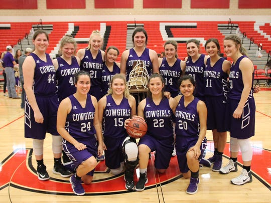 The Mason High School girls basketball team poses with their Region IV-2A championship trophy.