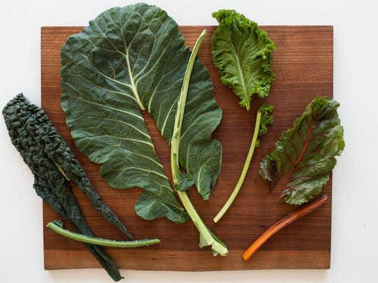 Removing the stalks from leafy greens before shredding