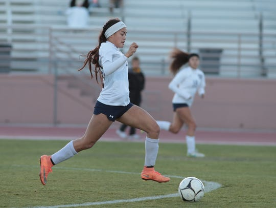 Tatiana Woodworth brings the ball down the field for