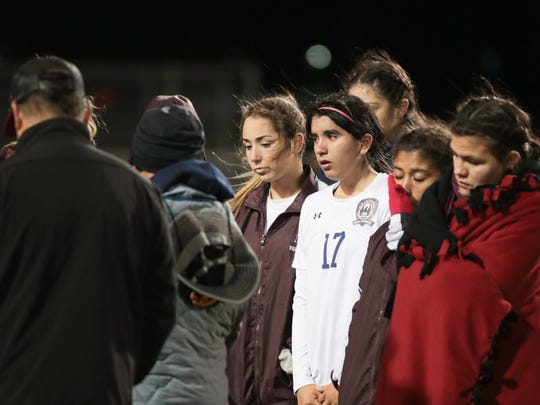 La Quinta players talk as a team after their CIF semifinal loss to Ventura, Tuesday, February 27, 2018.