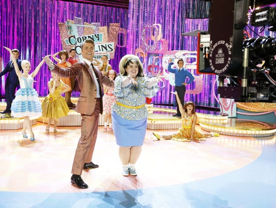 Maddie Baillio (Tracy Turnblad) and Derek Hough (Corny
