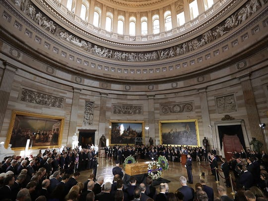 Christian evangelist and Southern Baptist minister Billy Graham's casket lies in honor during a ceremony attended by members of Congress and the Trump Administration in the Rotunda of the US Capitol in Washington, DC on Feb. 28,  2018. Graham was the nation's best know Christian evangelist, preaching to millions worldwide, as well as being an advisor to US presidents over his 6 decade career.