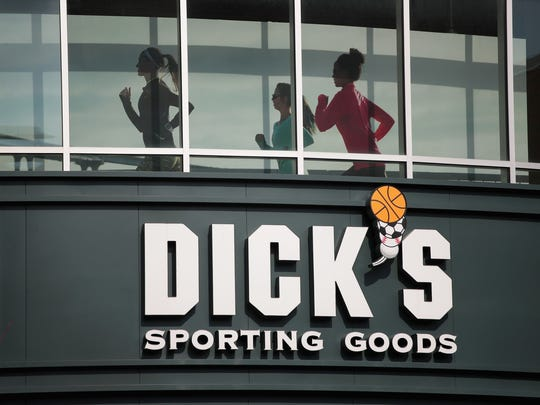 A sign hangs outside of a Dick's Sporting Goods store