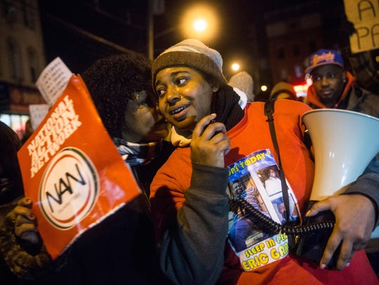 Erica Garner leads a march of people protesting the