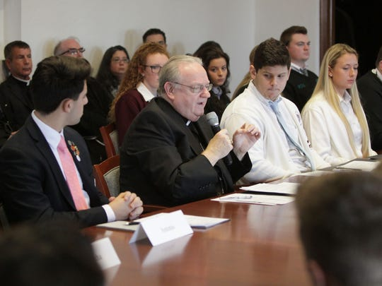 Diocese of Camden Bishop Dennis Sullivan speaks to Catholic high school students about a planned March 14 walkout in the wake of the Parkland school shooting.