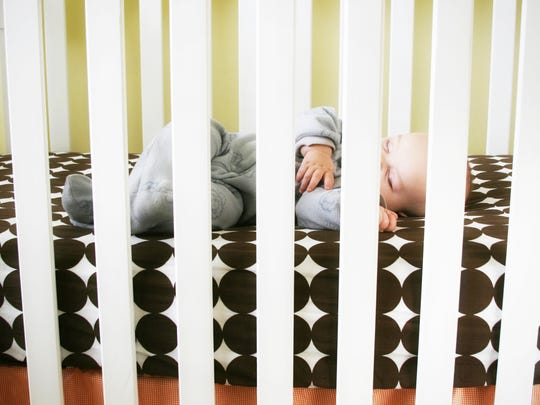 Getty Images/iStockphoto Sleeping baby inside a crib.