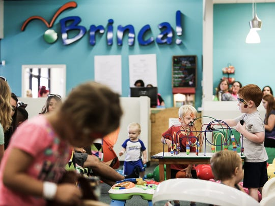 Guests play at Brinca!'s grand re-opening on September