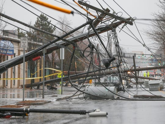 Wind knocks down power poles onto Arsenal Street in Watertown, Mass.