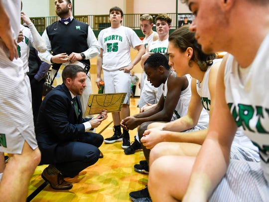 North head coach Jason Roach talks to his team during a time out as the Castle Knights play the North High Huskies for the Class 4A Sectional Championship at North Saturday, March 3, 2018.