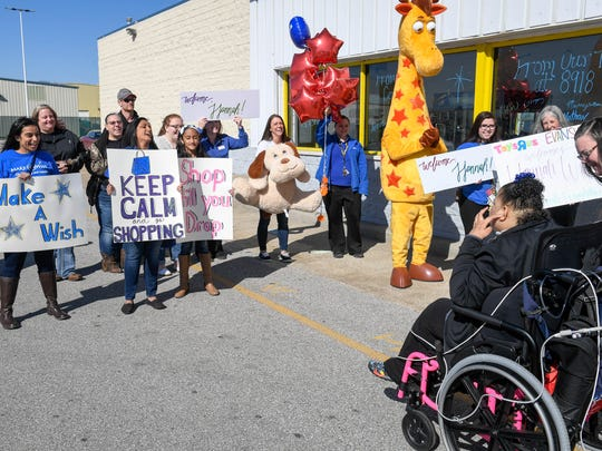 Friends and supporters with Jewelers for Children and Make-A-Wish greet Hannah West at Toys-R-Us as she starts a day long shopping spree Saturday. Hannah, from Evansville, battles Chronic Heart Failure, a condition in which the heart's function as a pump is inadequate to meet her body's needs, March 3, 2018.