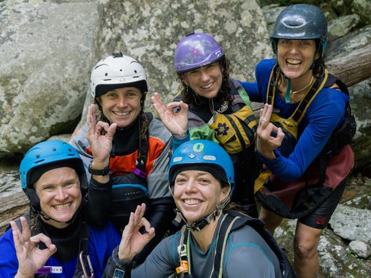 Maria Noakes, center in white helmet, with paddling friends, back row, Maria Noakes, Anna Levesque, Anne Sontheimer, and front row,  Christine Vogler and Rebecca Cramer.