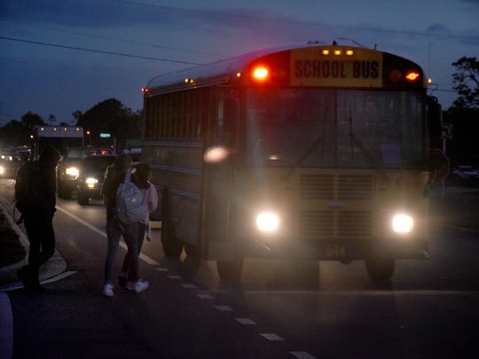 High school students head to school before sunrise.