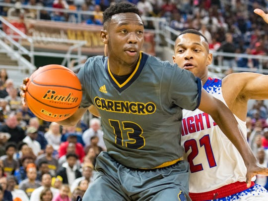 Jeremiah August drives to the basket as Carencro takes