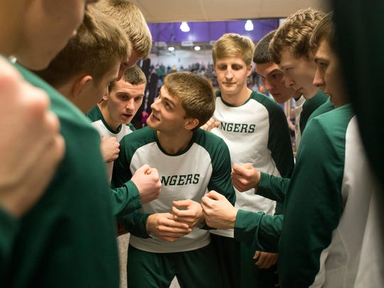 Forest Park's Noah Fleck, center, pumped up the team before Saturday's Class 2A regional championship game in Paoli. Forest Park defeated South Knox 55-41.