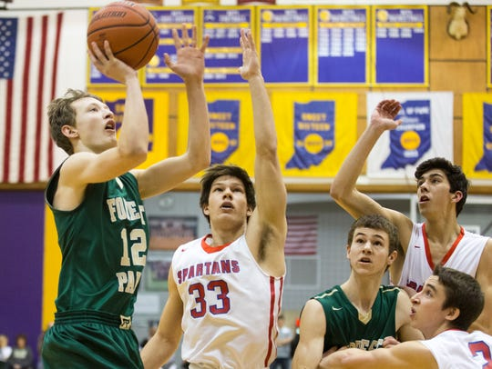 Forest Park's Isaac Uebelhor puts up a shot during last Saturday's Class 2A regional in Paoli.