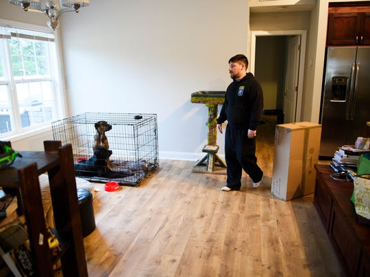 U.S. Army veteran Aaron Hillis walks through his living as he and his wife Elizabeth begin moving into their new home in Boiling Springs on Tuesday, March 6, 2018.