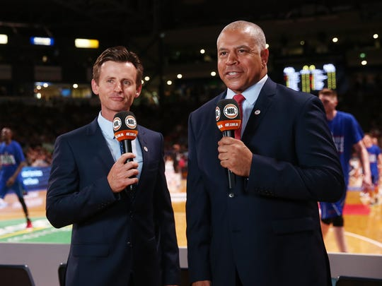 Former Hawkeye Steve Carfino, right, is a television icon in Australia.