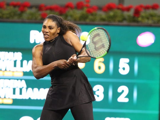 Serena Williams hits the ball during her third round