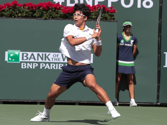 Hyeon Chung returns to Pablo Cuevas at the BNP Paribas Open, Wednesday, March 14, 2018.