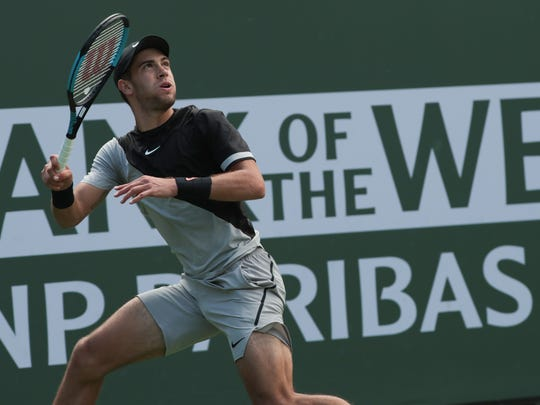 Borna Coric returns to Taylor Fritz at the BNP Paribas Open, Wednesday, March 14, 2018.
