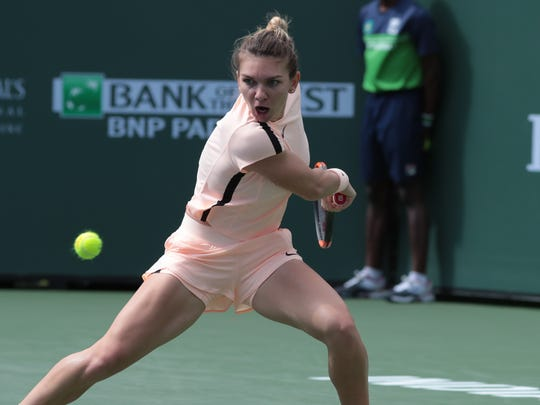 Simona Halep returns to Petra Martic at the BNP Paribas