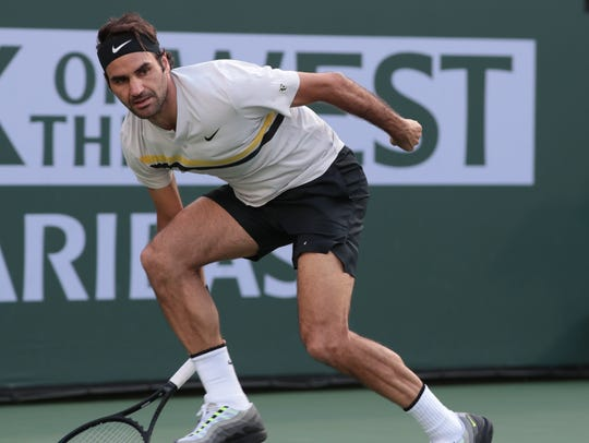 Roger Federer returns to Jeremy Chardy at the BNP Paribas