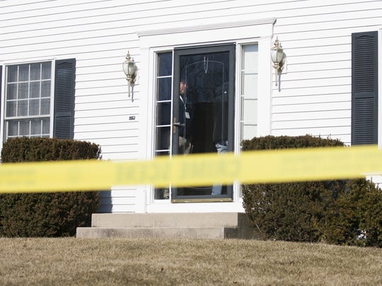 In this March 3, 2018 photo, Winnebago County Sheriff's investigators work at the scene of a double homicide and suicide at P.S. Ruckman Jr.'s home in unincorporated Winnebago County, Ill.
