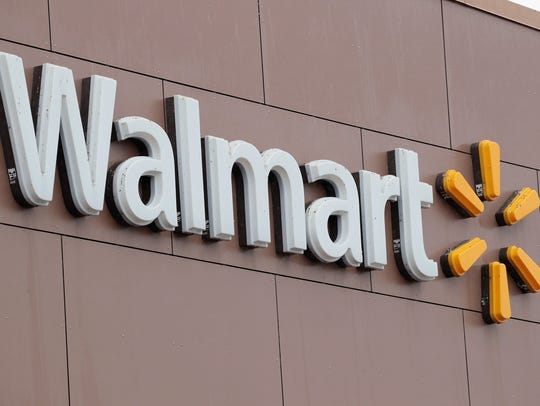 This file photo taken in 2018 shows a Walmart sign outside one of the retail giant's stores in Chicago, Illinois.