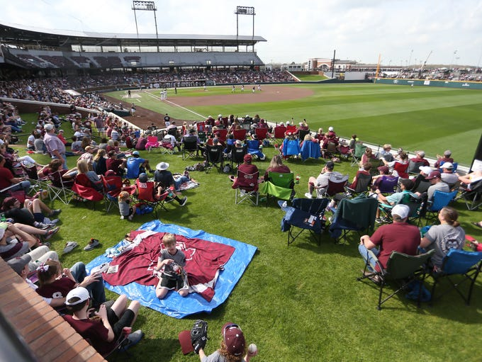 Fans watch the game from the berms. Mississippi State