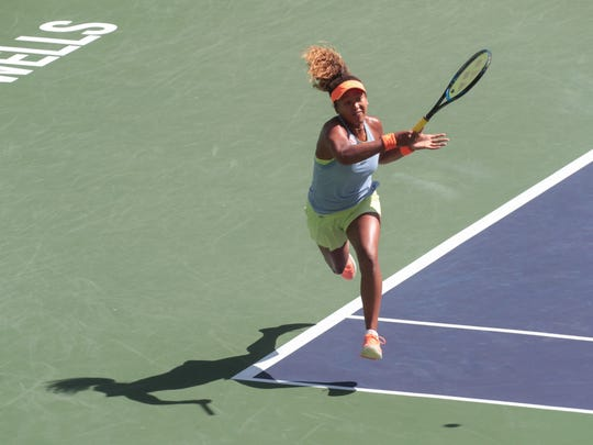 Naomi Osaka returns to Daria Kasatkina at the BNP Paribas Open, Sunday, March 18, 2018.