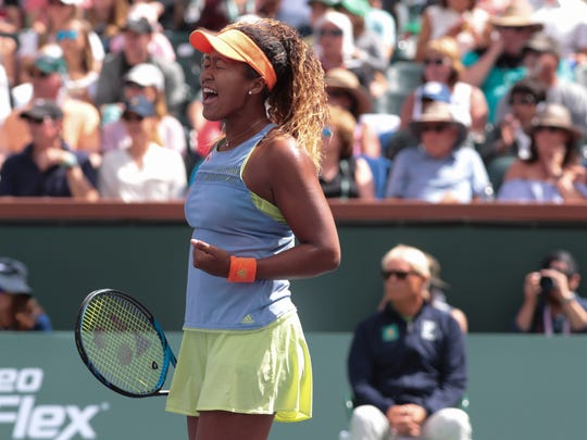 Naomi Osaka reacts to a point in her match against Daria Kasatkina at the BNP Paribas Open, Sunday, March 18, 2018.