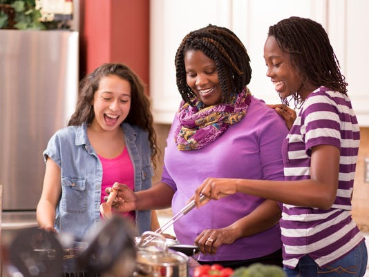 UVM Medical Center - Family at home cooking in the kitchen.