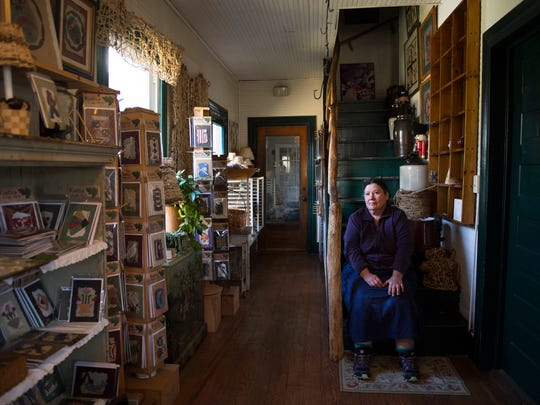 Nancy Basket, owner of Kudzu Kabin Designs, is pictured in the entryway of her home in Walhalla on Thursday, March 15, 2018. Her home doubles as a gift shop open to the public with products she makes from kudzu.
