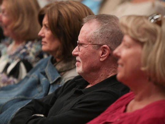 Audience members listen to performers at the Coachella Valley Storytellers March event, March 19, 2018.