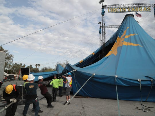 Workers raise the tent for Circus Vargas at the Westfield Mall in Palm Desert, Calif., March 20, 2018.