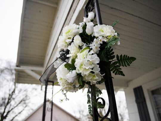 Flowers are displayed in front of the home of Jermaine