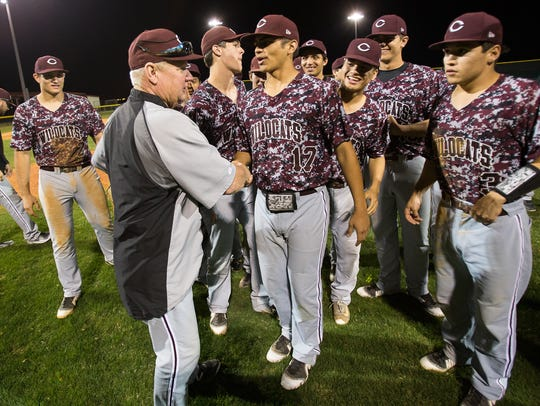 Calallen coach Steve Chapman is congratulated by his