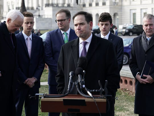Sen. Marco Rubio (R-Fla.), center, speaks as (left to right) Sen. Orrin Hatch (R-Utah), Patrick Petty, son of Ryan Petty, who lost his 14-year-old daughter Alaina Petty during the mass shooting at Marjory Stoneman Douglas High School, Kyle Kashuv, a junior at Marjory Stoneman Douglas High School, and Dan Sullivan (R-Alaska) listen during a news conference in front of the U.S. Capitol on March 13, 2018. Sen. Hatch held a news conference to discuss the STOP School Violence Act. (Photo by Alex Wong/Getty Images) ORG XMIT: 775140110 ORIG FILE ID: 931524572