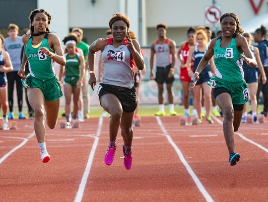 Claudasha Watson wins the girls 100 meter dash at the Beaver Club Relays. Friday, March 23, 2018.