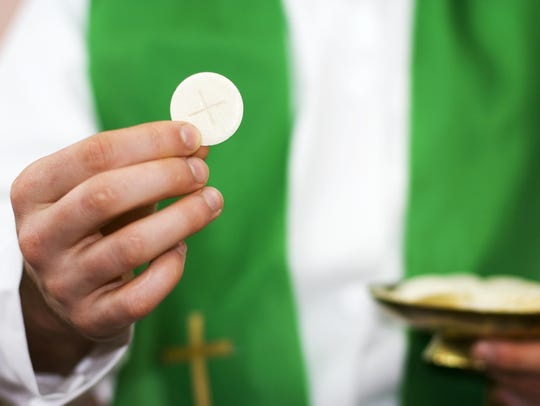 Communion and clergyman.