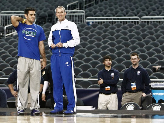 Joey Cantens, the former FGCU director of basketball operations, left, with then-Eagles coach Andy Enfield before the Sweet 16 matchup with Florida at Cowboys Stadium in Arlington, Texas, in 2013. Cantens is coaching overseas and seems a likely candidate to join new FGCU coach Michael Fly's staff.