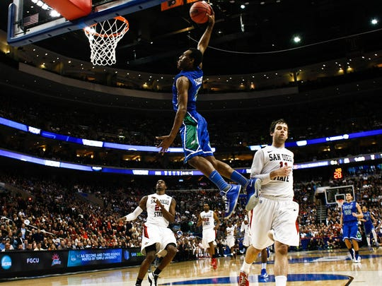 FGCU's Bernard Thompson soars over San Diego State players for a dunk during their game in the second round of the NCAA tournament on Sunday, March 24, 2013, at the Wells Fargo Center.