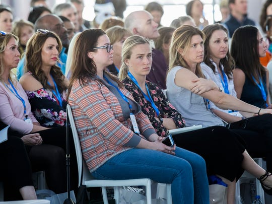 Women and girls listen to American actress Ashley Judd speak at the ANA Inspiring Women in Sports Conference at Mission Hills Country Club on March 27, 2018.
