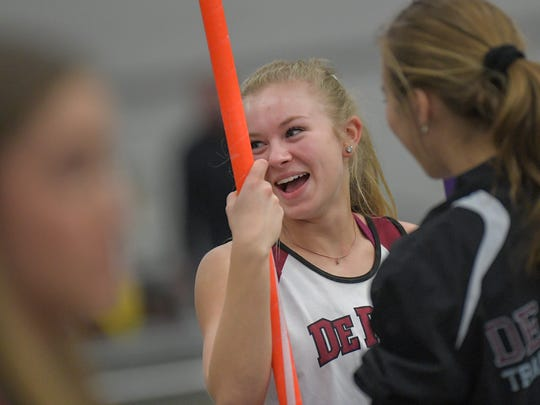 Lindsay Ruf of De Pere waits for her turn in the pole vault during the Oshkosh High School Invitational Big School track meet March 26.