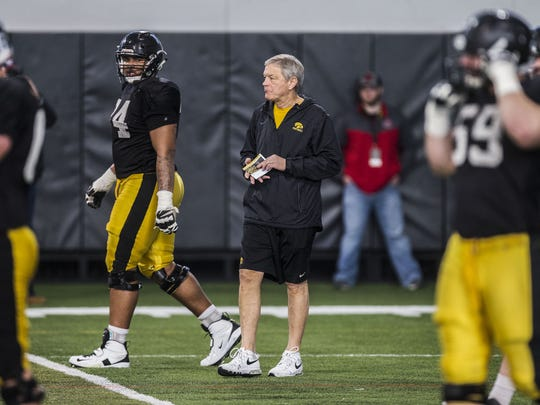 Iowa football head coach Kirk Ferentz watches the team during a spring football practice on Wednesday, March 28, 2018, at the Iowa football performance center in Iowa City.