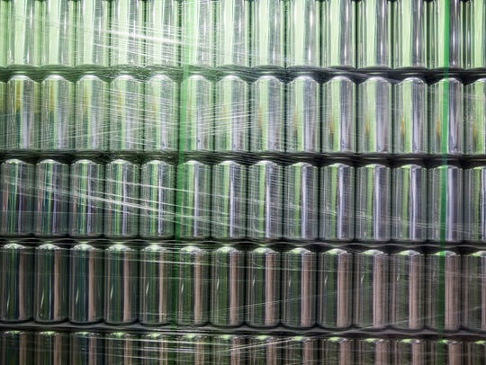 Rows of cans sit ready to be filled with beer on Big