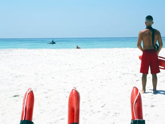 636578523139420801-Navarre-Beach-lifeguards.jpg