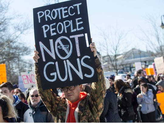 Protesters gather at the Red Bank train station and march to Riverside Gardens Park in Red Bank, New Jersey in solidarity with the national March for our Lives to end gun violence.