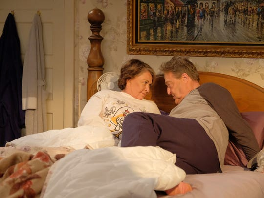 Roseanne and Dan (John Goodman) chat in bed in the